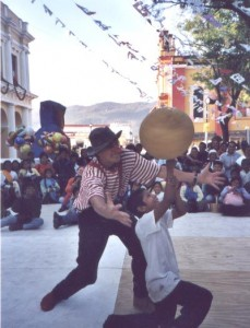 chiapas, mexico. boy youth audience member spins a large ball on his finger. celebrating our 100th project